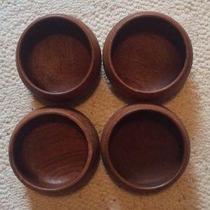 Set of 4 hand carved teak bowls.